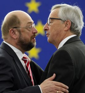 President of the European Commission Jean-Claude Juncker, right, discusses with President of the European parliament Martin Schulz before delivering his statement on growth, jobs and investment package for Europe, Wednesday Nov 26, 2014 at the European Parliament in Strasbourg, eastern France. (AP Photo/Christian Lutz)
