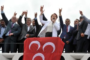 Former Turkish Interior minister and lawmaker of Turkey's right-wing Nationalist Movement Party (MHP) Meral Aksener (C) speaks to supporters as riot police sealed off a hotel to prevent thousands of MHP dissidents from holding a party congress in Ankara, on May 15, 2016. Members of the MHP party were prevented from holding a congress on May 15 aimed at unseating longtime leader Devlet Bahceli and recovering ground lost to President Recep Tayyip Erdogan's party. Dissidents from the Nationalist Movement Party launched a campaign to oust Bahceli after a general election in November in which the party shed half its support -- taking just 40 seats in the 550-member parliament compared to 80 five months previously. / AFP / ADEM ALTAN (Photo credit should read ADEM ALTAN/AFP/Getty Images)